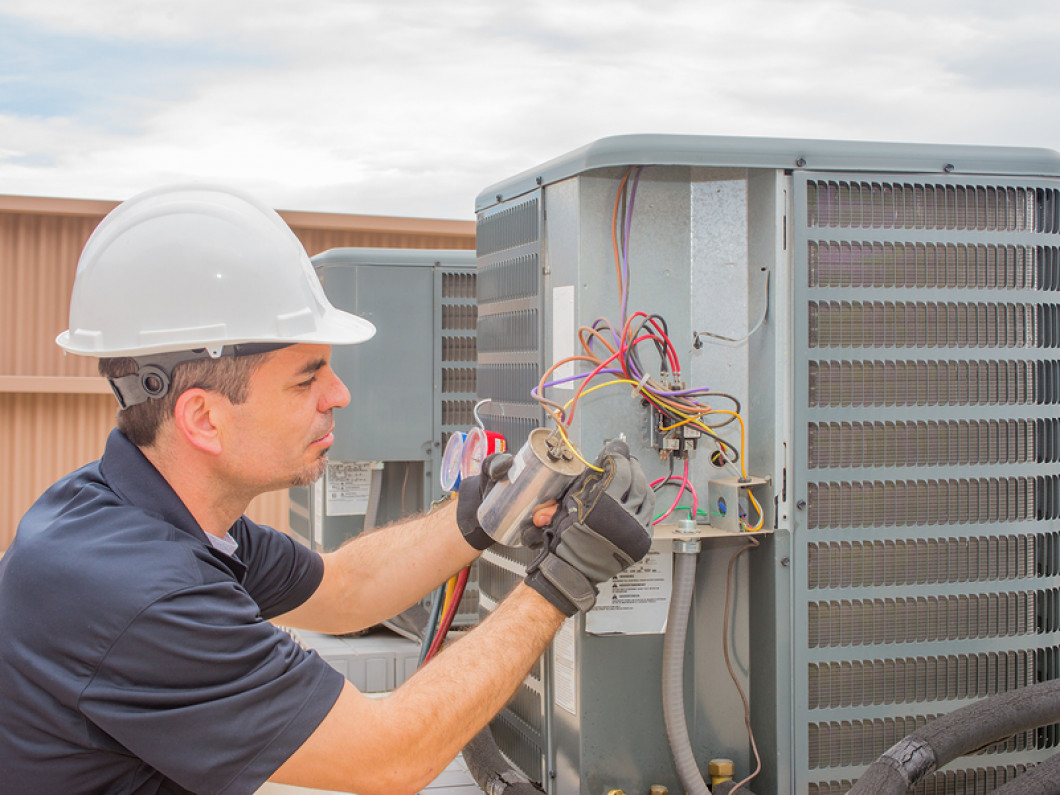hvac contractor doing a air conditioning repair in Tuscaloosa, AL